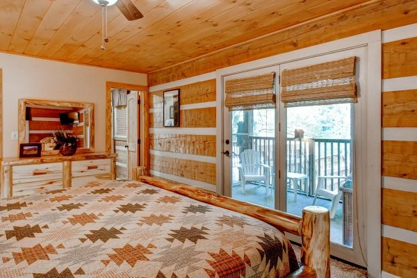 Bedroom with deck access at Creekside Comfort, a 3-bedroom cabin rental located in Pigeon Forge