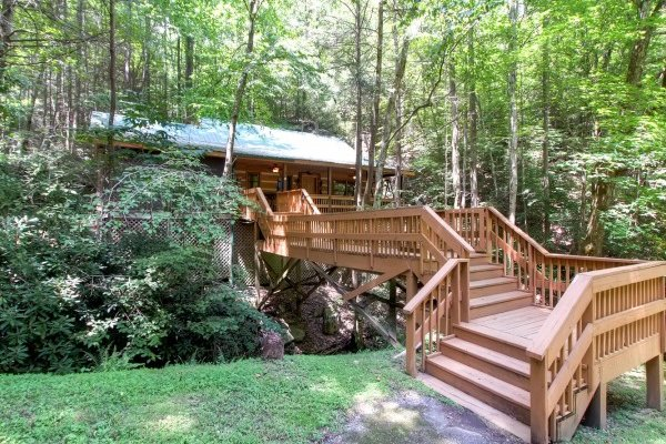 Entry way deck over the creek at Creekside Comfort, a 3-bedroom cabin rental located in Pigeon Forge