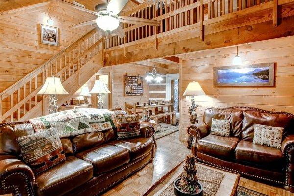Living room with vaulted ceilings and plenty of light at Creekside Comfort, a 3-bedroom cabin rental located in Pigeon Forge