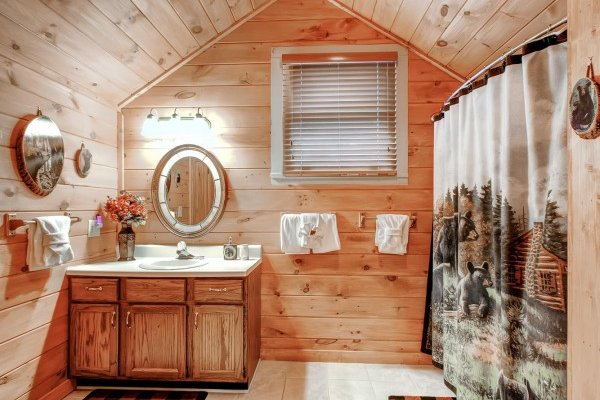 Loft bathroom with a tub and shower at Creekside Comfort, a 3-bedroom cabin rental located in Pigeon Forge