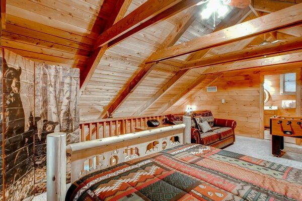 Loft room with a bear motif at Creekside Comfort, a 3-bedroom cabin rental located in Pigeon Forge
