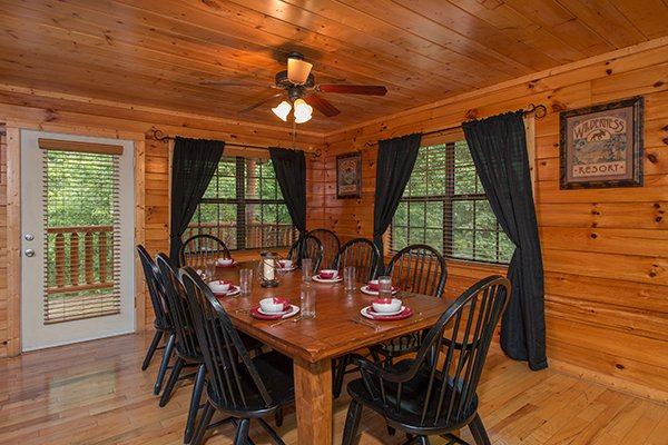 Dining space with seating for eight at Family Ties Lodge, a 4-bedroom cabin rental located in Pigeon Forge