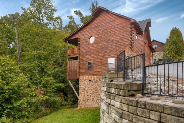 Yard and cabin exterior at Family Ties Lodge, a 4-bedroom cabin rental located in Pigeon Forge