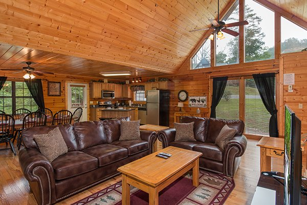 Open concept main floor with loft windows at Family Ties Lodge, a 4-bedroom cabin rental located in Pigeon Forge