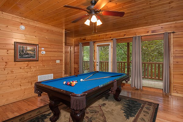 Pool table at Family Ties Lodge, a 4-bedroom cabin rental located in Pigeon Forge
