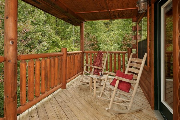 Two deck rockers looking into the woods at Family Ties Lodge, a 4-bedroom cabin rental located in Pigeon Forge
