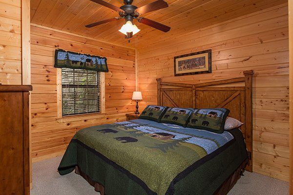 Bedroom with a king-sized bed at Family Ties Lodge, a 4-bedroom cabin rental located in Pigeon Forge