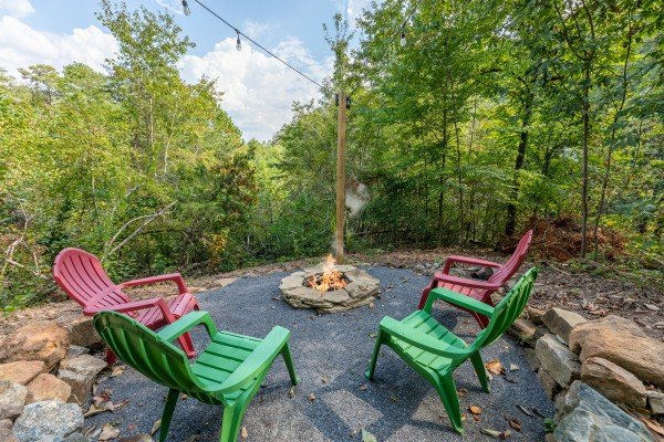Backyard fire pit at Misty Mountain Sunrise, a 3 bedroom cabin rental located in Pigeon Forge