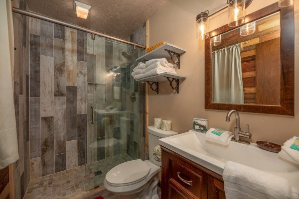 Bathroom with a tub and shower at Misty Mountain Sunrise, a 3 bedroom cabin rental located in Pigeon Forge