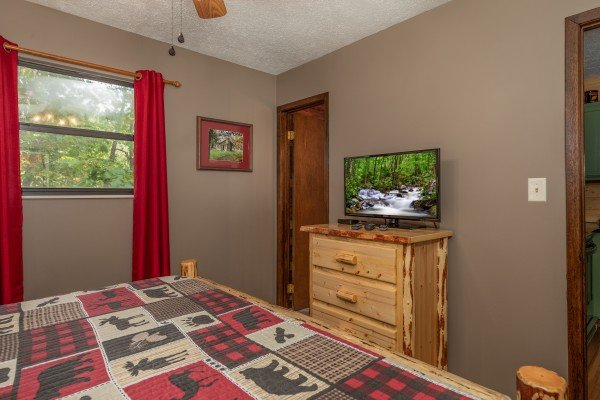 Dresser and TV in a bedroom at Misty Mountain Sunrise, a 3 bedroom cabin rental located in Pigeon Forge