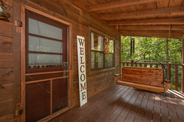Front Porch with a swing at Misty Mountain Sunrise, a 3 bedroom cabin rental located in Pigeon Forge