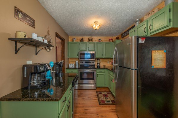 Kitchen with stainless appliances at Misty Mountain Sunrise, a 3 bedroom cabin rental located in Pigeon Forge