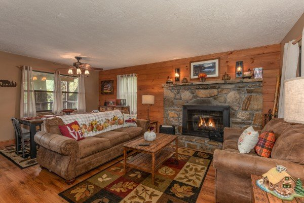 Living room with fireplace at Misty Mountain Sunrise, a 3 bedroom cabin rental located in Pigeon Forge