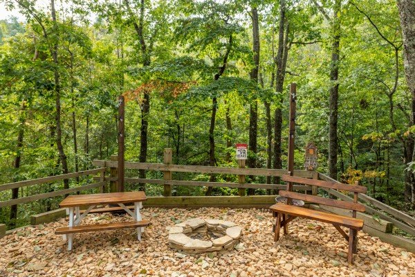 Picnic area with fire pit at Misty Mountain Sunrise, a 3 bedroom cabin rental located in Pigeon Forge