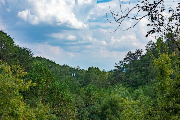 Wooded view at Misty Mountain Sunrise, a 3 bedroom cabin rental located in Pigeon Forge