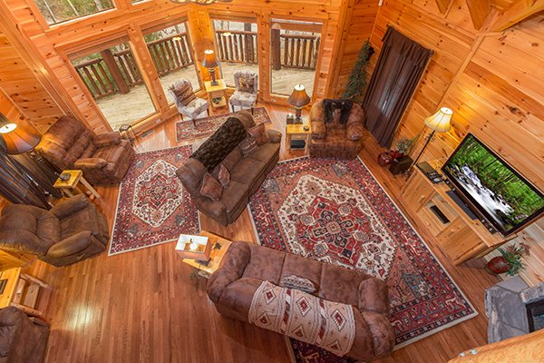 Living room from above at Smokies Paradise Lodge, a 5 bedroom cabin rental located in Pigeon Forge