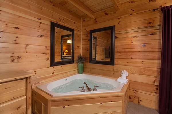 Jacuzzi in a bedroom at Smokies Paradise Lodge, a 5 bedroom cabin rental located in Pigeon Forge