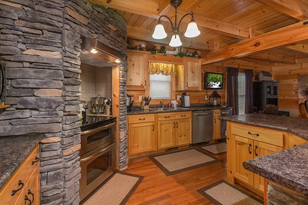 Custom kitchen at Smokies Paradise Lodge, a 5 bedroom cabin rental located in Pigeon Forge