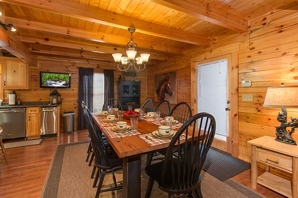 Dining table for 8 at Smokies Paradise Lodge, a 5 bedroom cabin rental located in Pigeon Forge