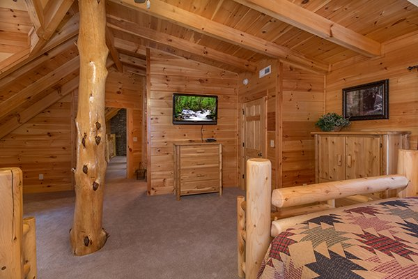 Dresser and tv in the double bedroom at Smokies Paradise Lodge, a 5 bedroom cabin rental located in Pigeon Forge