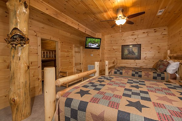 Double bedroom with a TV at Smokies Paradise Lodge, a 5 bedroom cabin rental located in Pigeon Forge