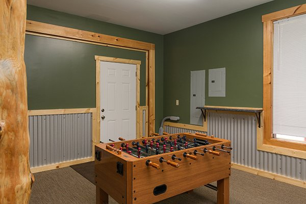 Foosball table at Smokies Paradise Lodge, a 5 bedroom cabin rental located in Pigeon Forge