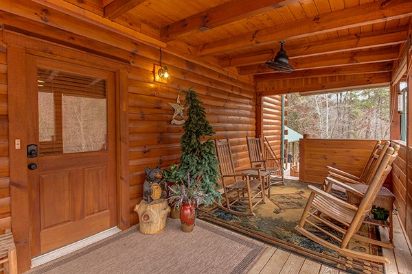 Front porch at Smokies Paradise Lodge, a 5 bedroom cabin rental located in Pigeon Forge