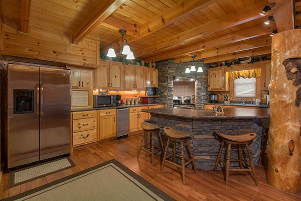 Breakfast bar and kitchen at Smokies Paradise Lodge, a 5 bedroom cabin rental located in Pigeon Forge