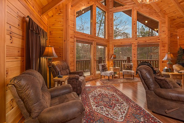 Lots of seating in the living room at Smokies Paradise Lodge, a 5 bedroom cabin rental located in Pigeon Forge