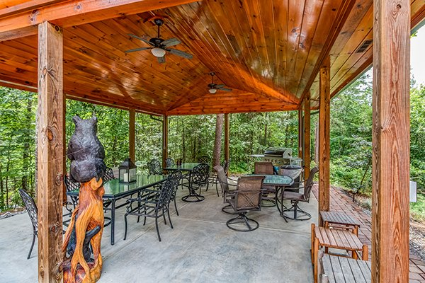 Dining in the pavilion at Smokies Paradise Lodge, a 5 bedroom cabin rental located in Pigeon Forge