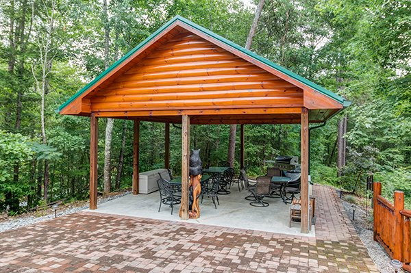 Patio pavilion for outdoor dining at Smokies Paradise Lodge, a 5 bedroom cabin rental located in Pigeon Forge