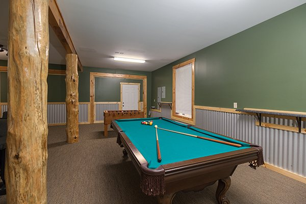 Pool table at Smokies Paradise Lodge, a 5 bedroom cabin rental located in Pigeon Forge