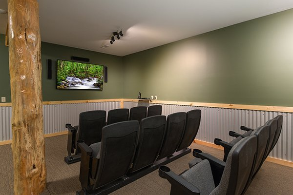 Theater room with movie seats at Smokies Paradise Lodge, a 5 bedroom cabin rental located in Pigeon Forge