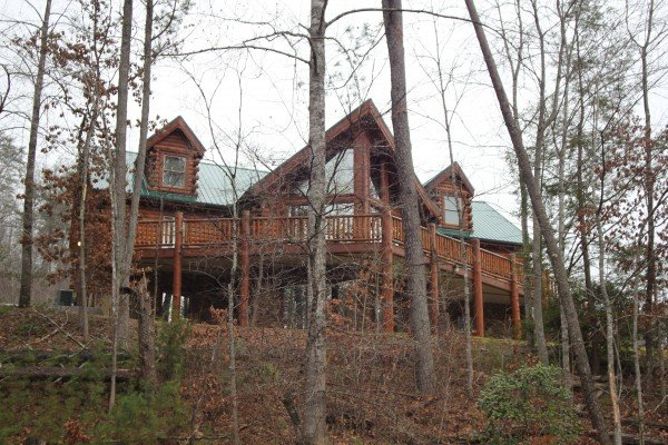 Looking through the trees at Smokies Paradise Lodge, a 5 bedroom cabin rental located in Pigeon Forge