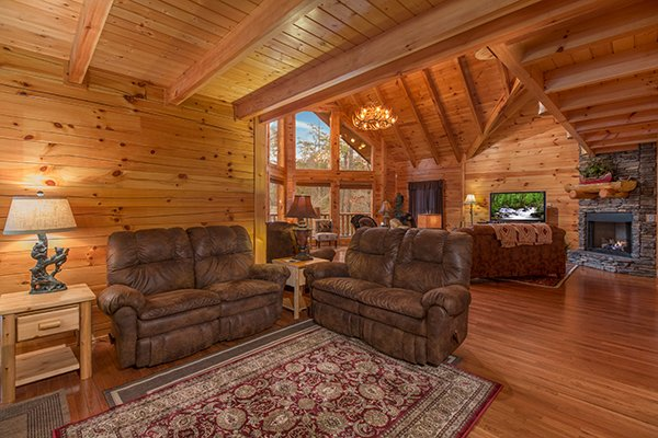 Loveseats in the living room at Smokies Paradise Lodge, a 5 bedroom cabin rental located in Pigeon Forge