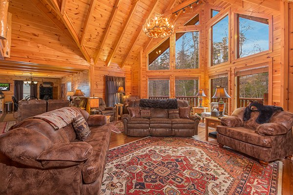 Living room with two sofas and an oversized chair at Smokies Paradise Lodge, a 5 bedroom cabin rental located in Pigeon Forge
