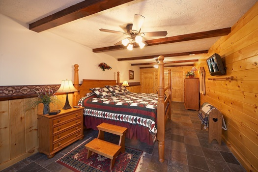 first floor king bedroom at perfection! a 3 bedroom cabin rental located in gatlinburg