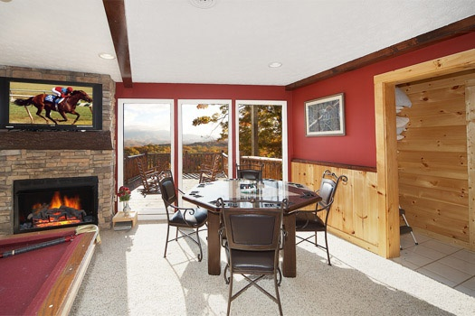Game room with poker table at Perfection! A 3 bedroom cabin rental located in Gatlinburg