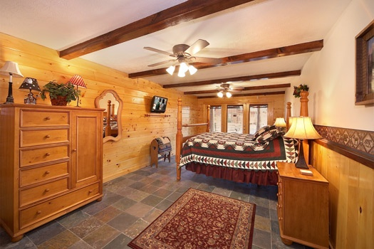 king bedroom with outside access at perfection! a 3 bedroom cabin rental located in gatlinburg