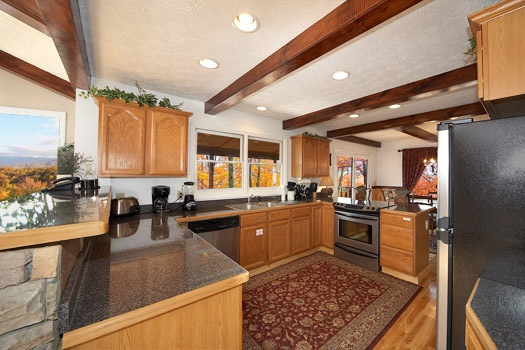 kitchen and breakfast bar area at perfection! a 3 bedroom cabin rental located in gatlinburg
