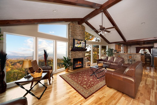 living room with fireplace at perfection! a 3 bedroom cabin rental located in gatlinburg