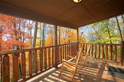 lower level deck with rocking chairs at perfection! a 3 bedroom cabin rental located in gatlinburg