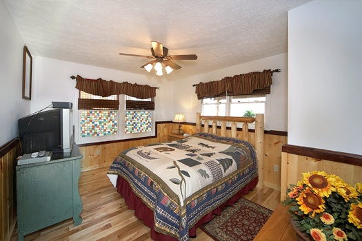 main level bedroom with queen bed at perfection! a 3 bedroom cabin rental located in gatlinburg