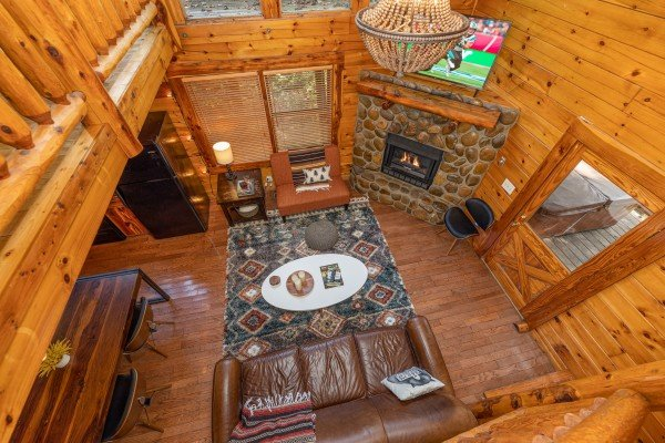 Looking down at the living room at Silver Creek Cabin, a 1 bedroom cabin rental located in Pigeon Forge