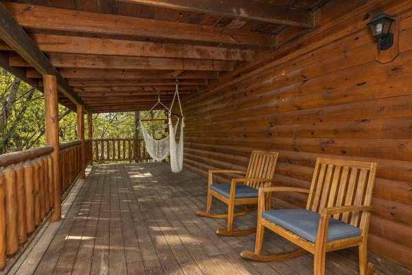 Chairs and hammocks on a deck at Silver Creek Cabin, a 1 bedroom cabin rental located in Pigeon Forge