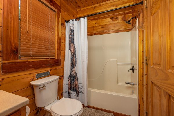 Bathroom with a tub and shower at Silver Creek Cabin, a 1 bedroom cabin rental located in Pigeon Forge
