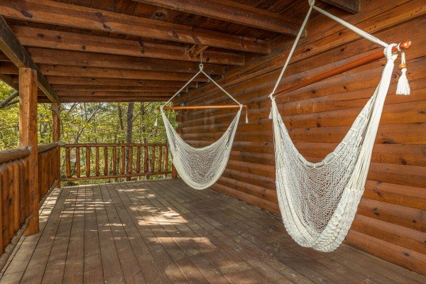 Hammocks on a deck at Silver Creek Cabin, a 1 bedroom cabin rental located in Pigeon Forge
