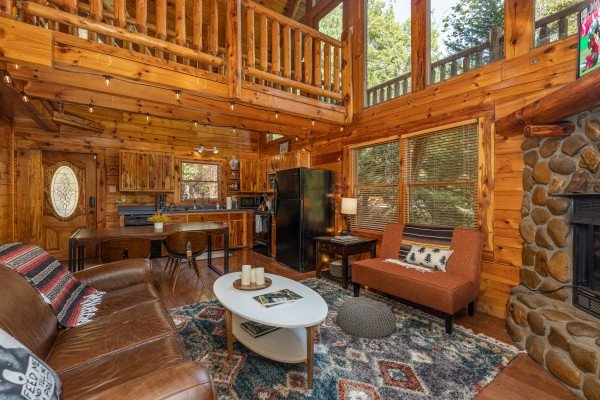Living room and dining room at Silver Creek Cabin, a 1 bedroom cabin rental located in Pigeon Forge